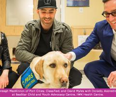Breagh MacKinnon, Classified, and David Myles with Dorado, accredited Facility dog